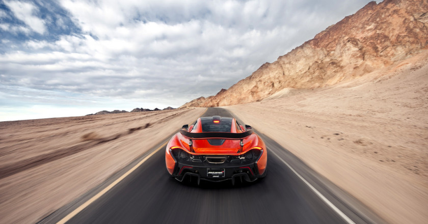 Orange McLaren P1 Accelerating