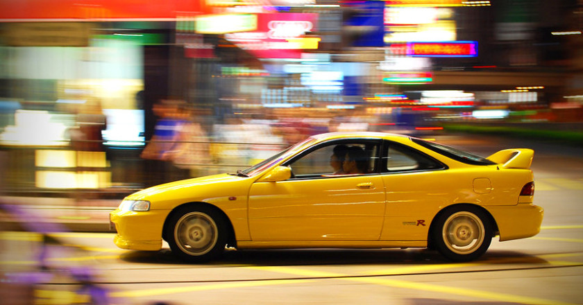 Yellow Integra Type-R Driving Through City